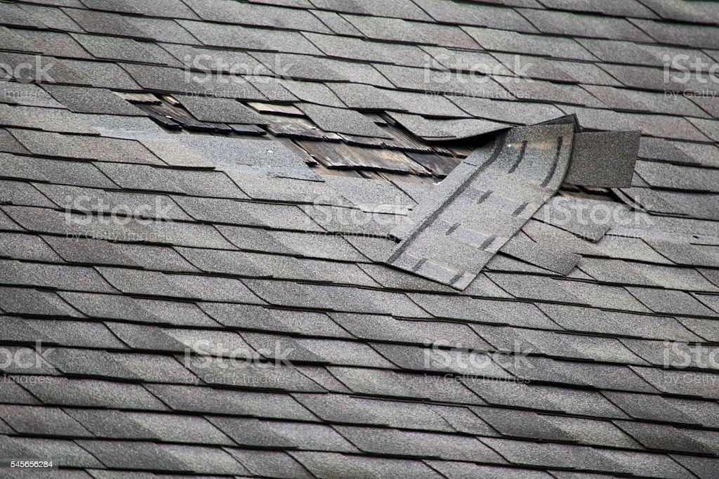Damaged Roof Shingles stock photo