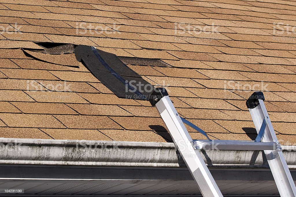 Damaged Roof Shingles Repair stock photo