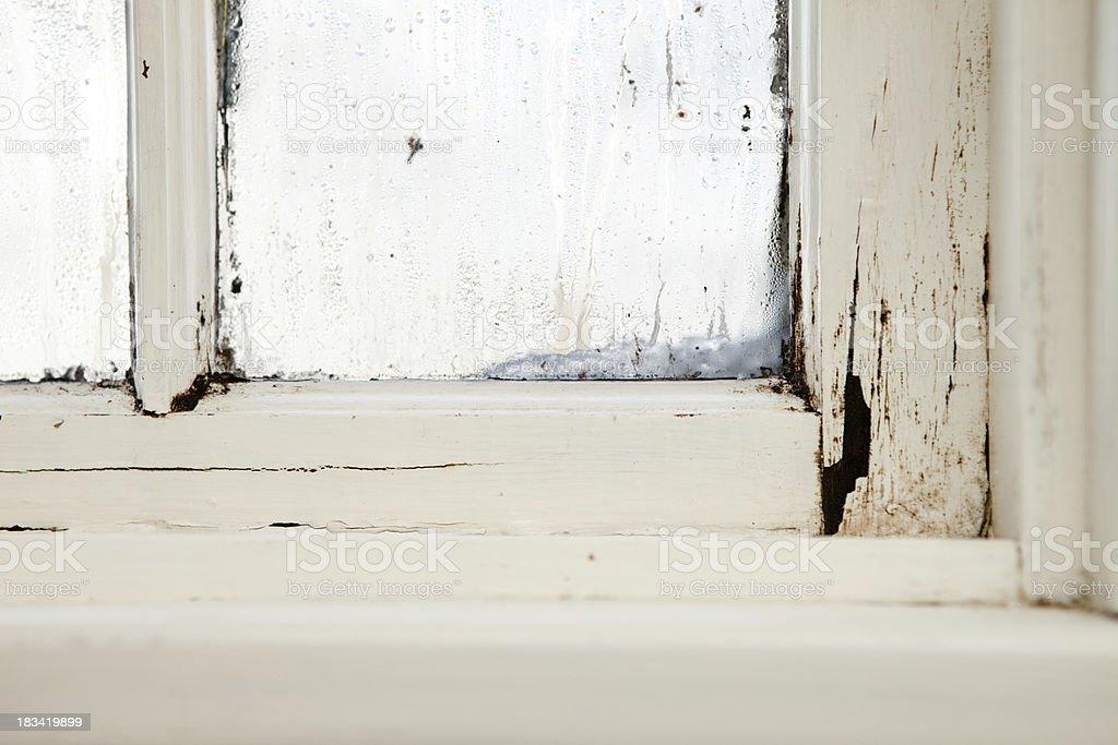Damaged, Rotting Window Inside Older Home stock photo