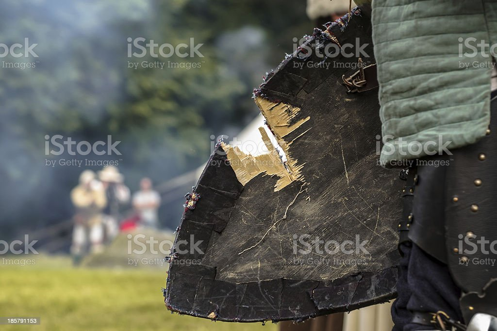Damaged shield of medieval knight royalty-free stock photo