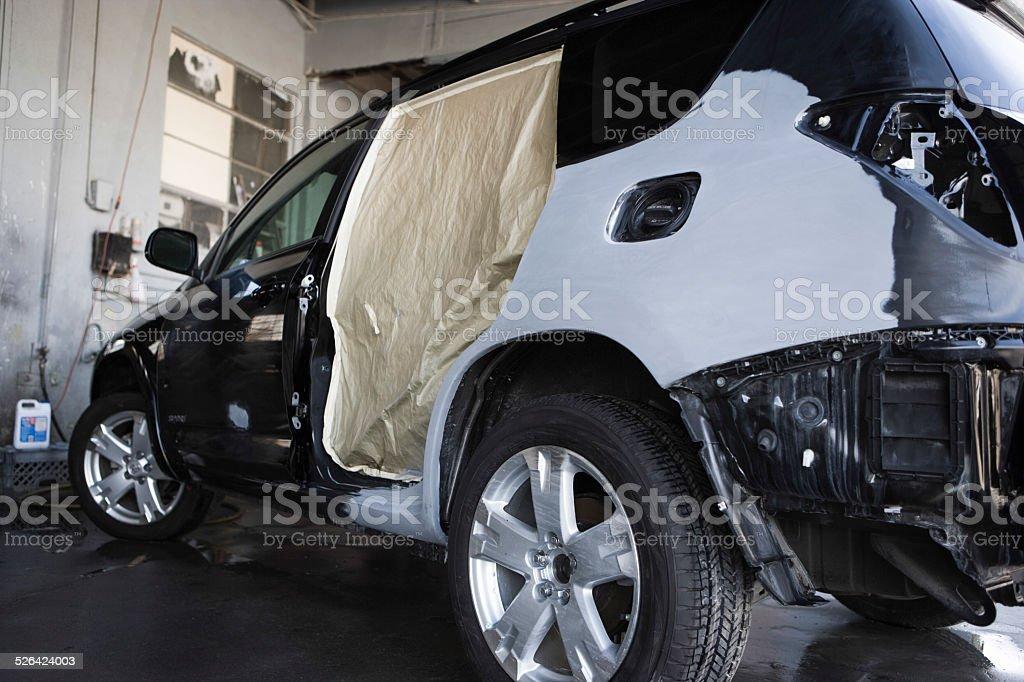 Damaged SUV In Garage stock photo