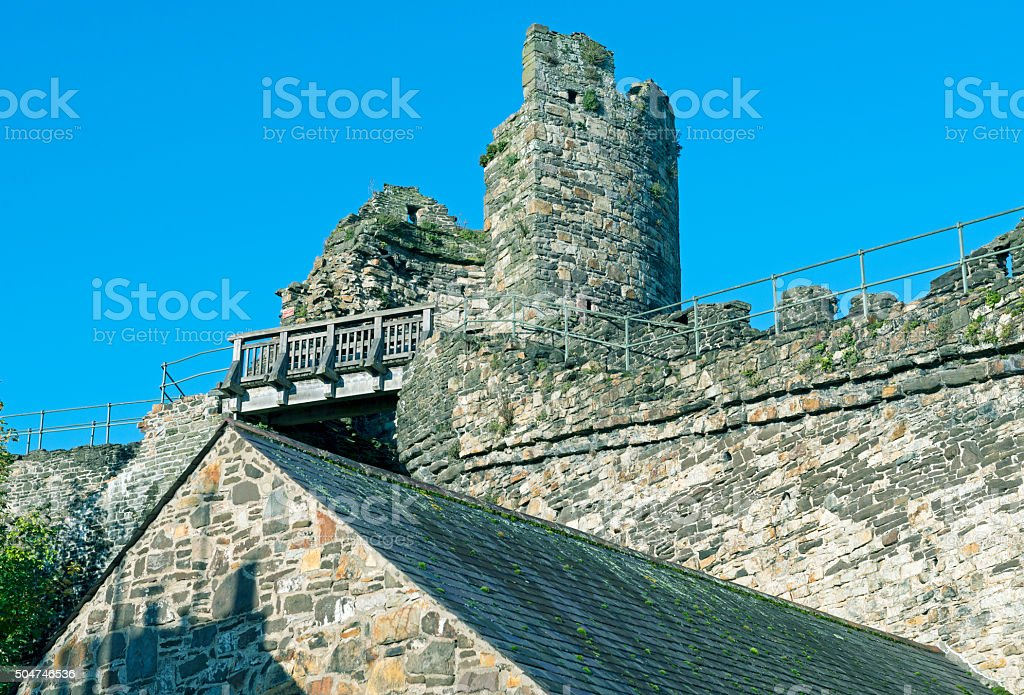 Damaged tower on medieval wall around Conwy Wales stock photo