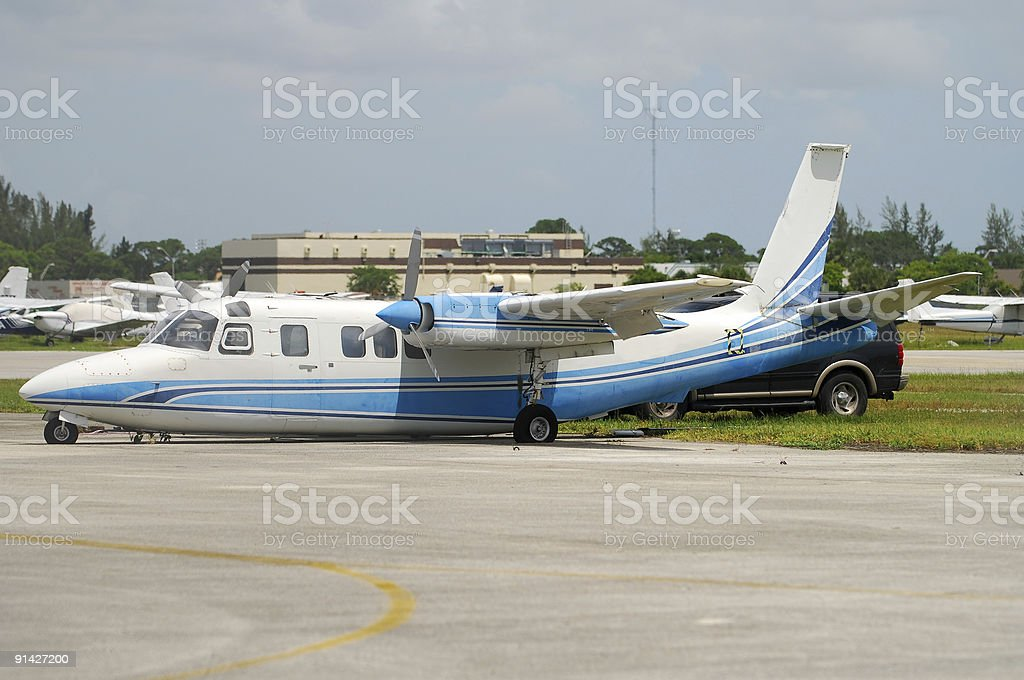 Damaged turboprop airplane stock photo