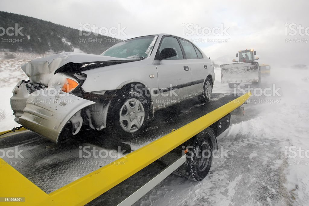 Damages car on the back of a truck after accident royalty-free stock photo