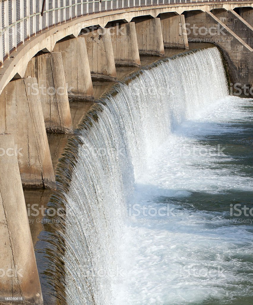 Damn with water pouring through pressure holes stock photo