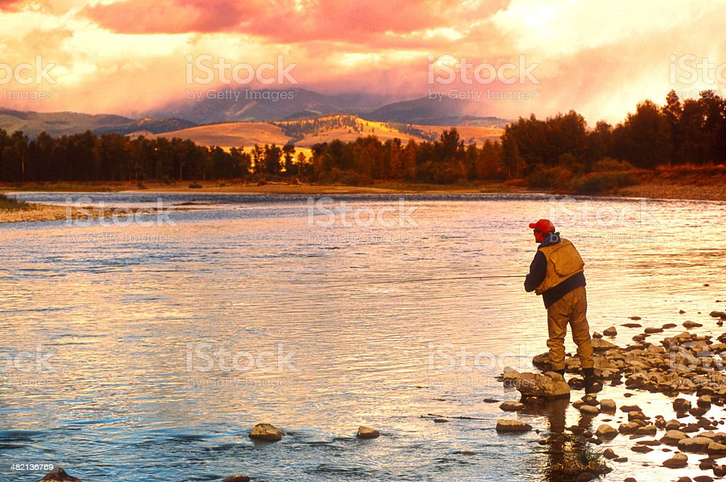 Damon Fishing on the Big Blackfoot River in Montana stock photo
