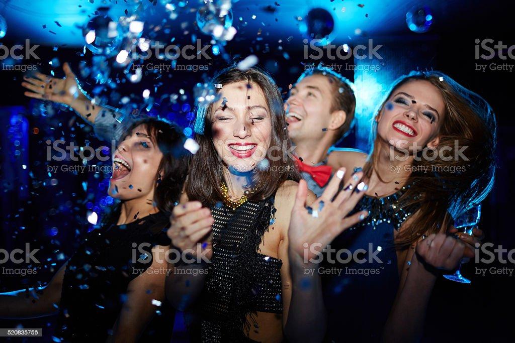 Dance among confetti stock photo