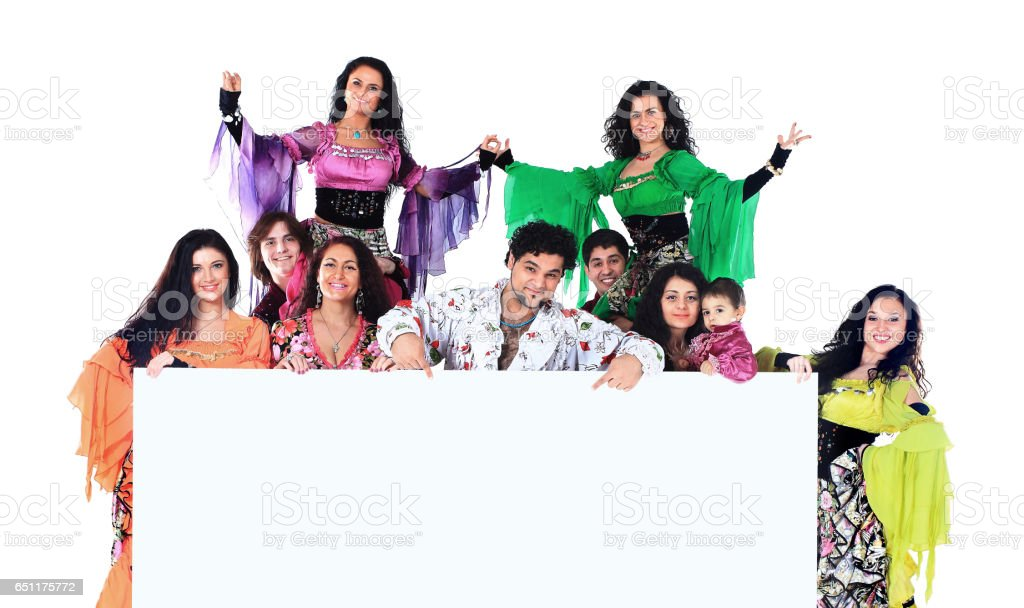 Dance group of Gypsies, are holding a huge banner and show up on your ad copy stock photo