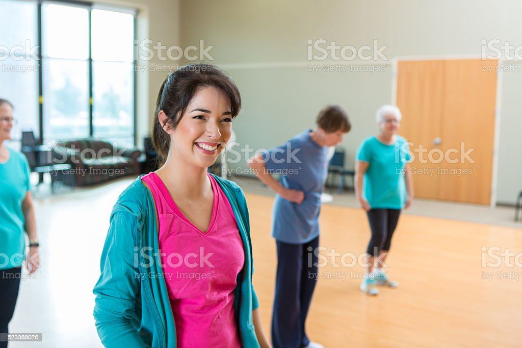 Dance instructor before class at senior center stock photo