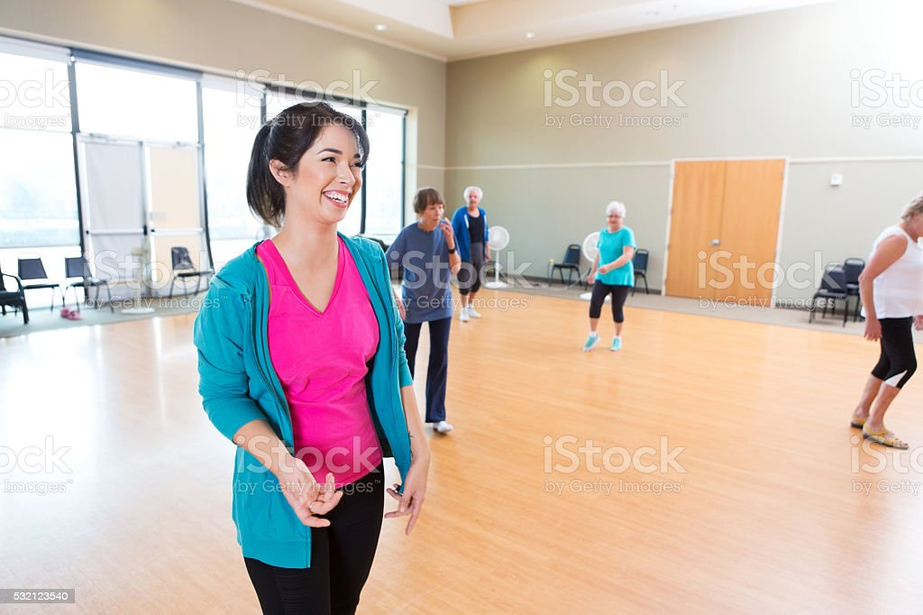 Dance instructor has fun teaching class stock photo