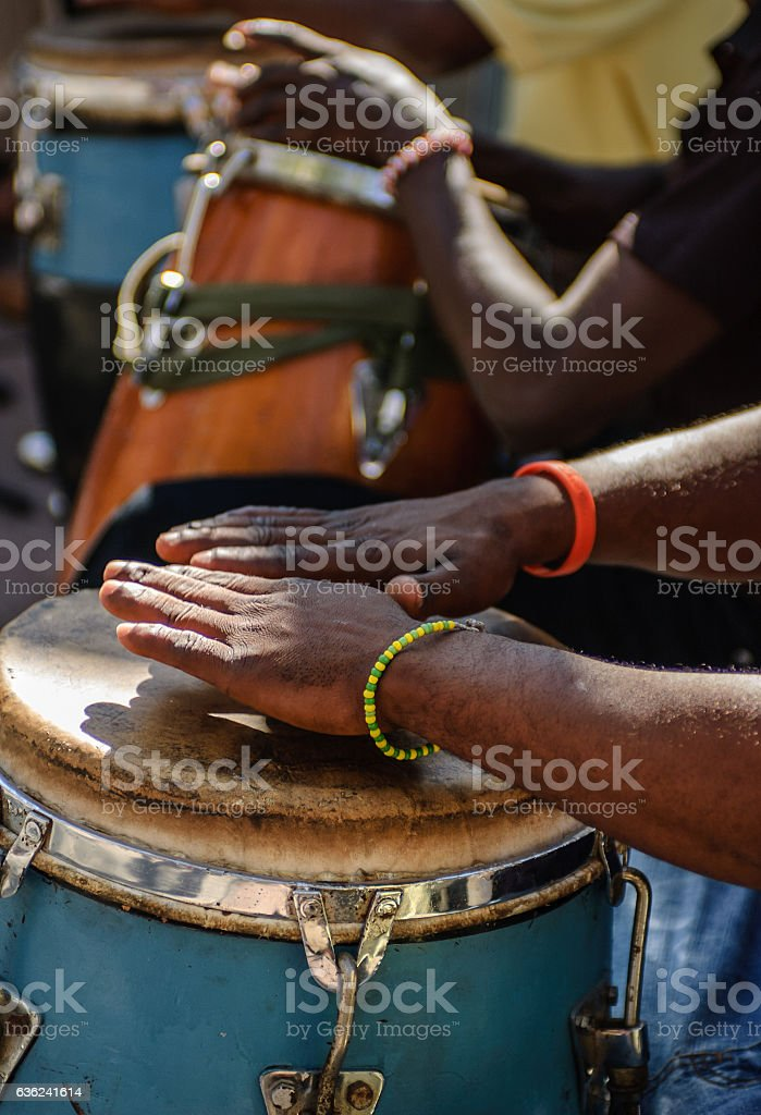 Dance music by drumming on Bongo drums in Cuba stock photo