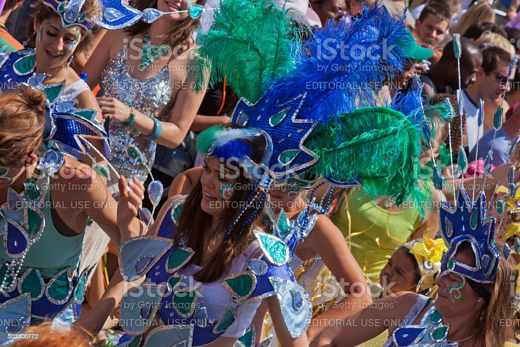 Dance troupe in carnival parade through inner city Bristol UK stock photo