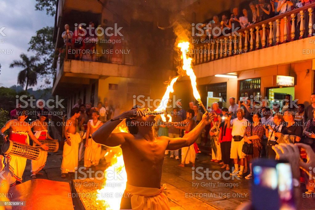Dance with fire in front of Sacred Tooth Relic Temple stock photo