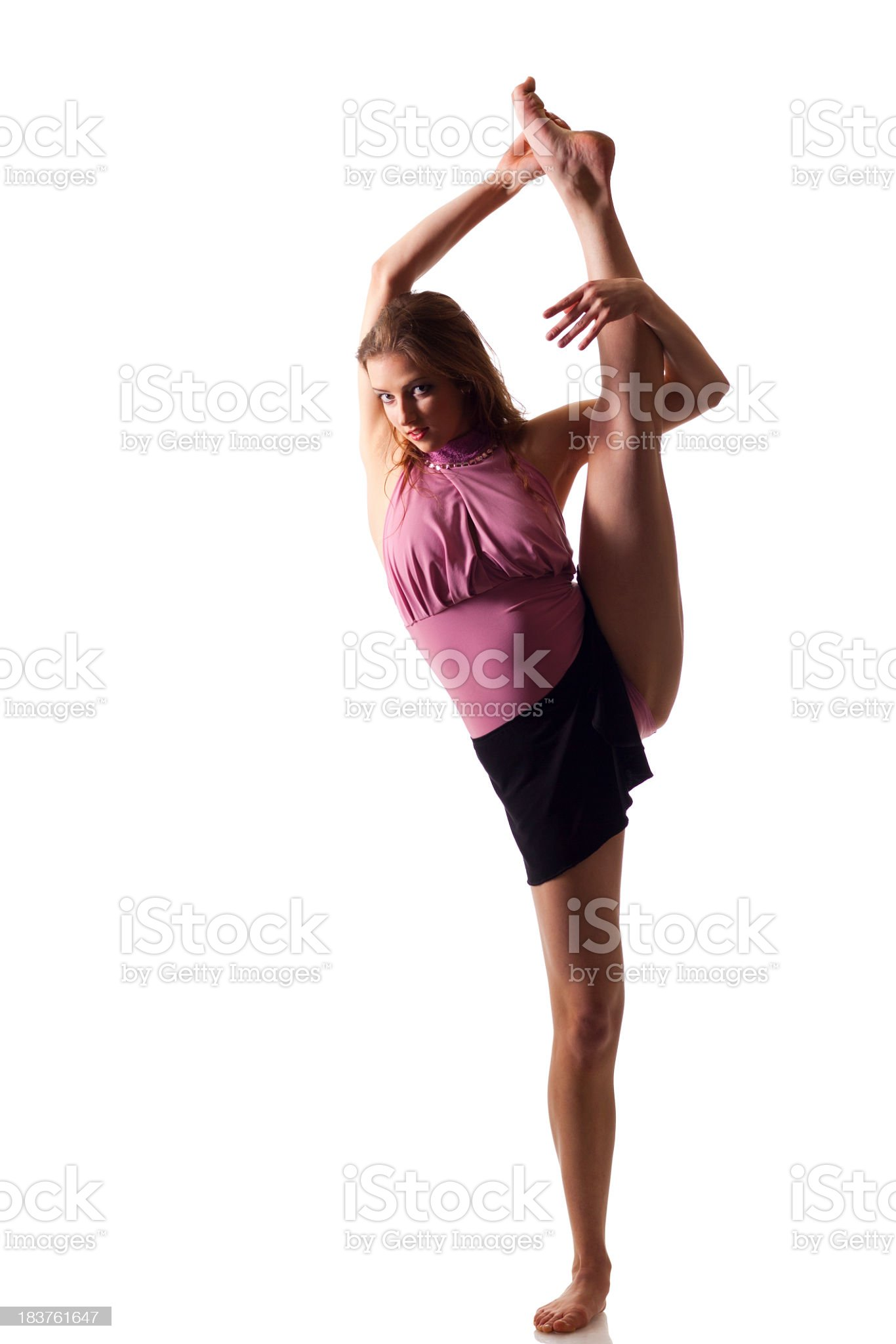 Dancer does a split on white background royalty-free stock photo