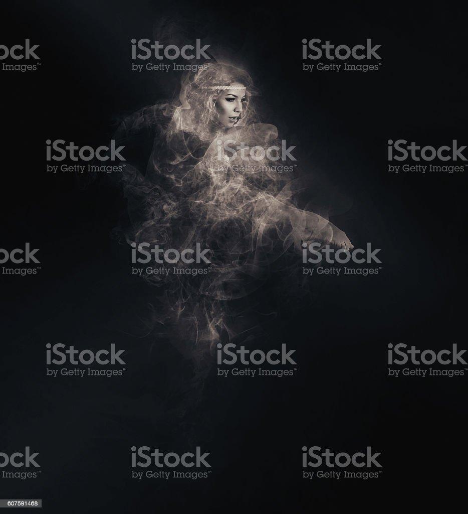 Dancer from smoke on the dark background stock photo
