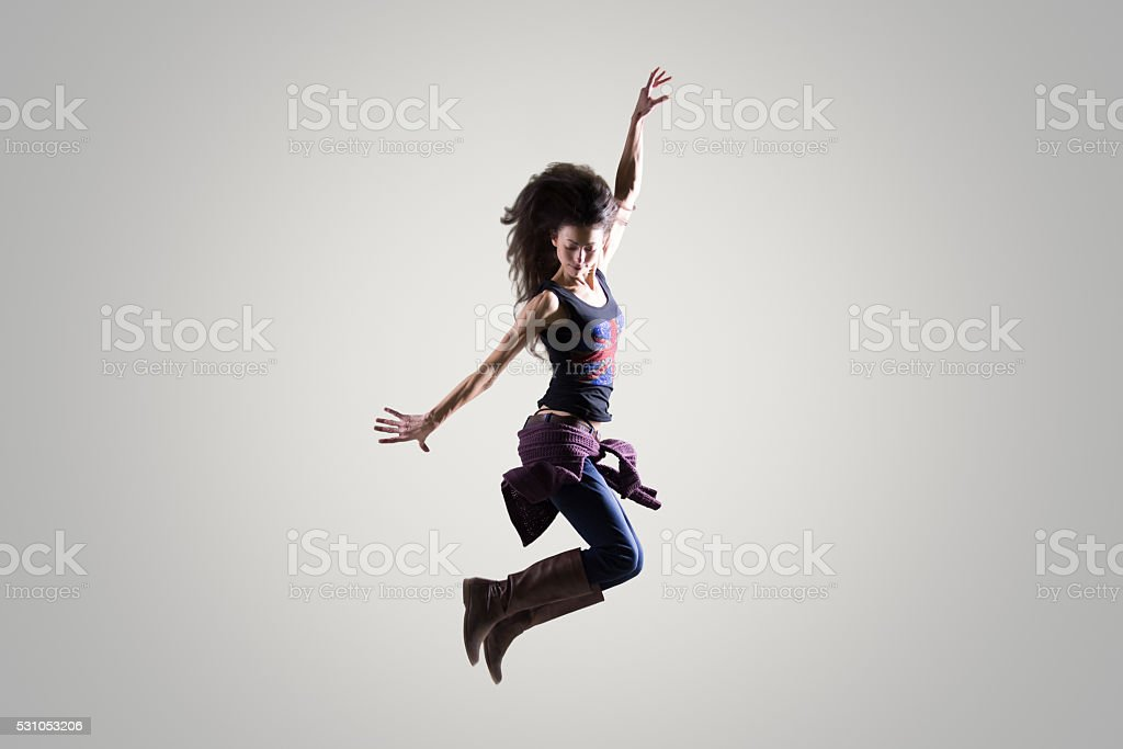 Dancer girl jumping in the air stock photo