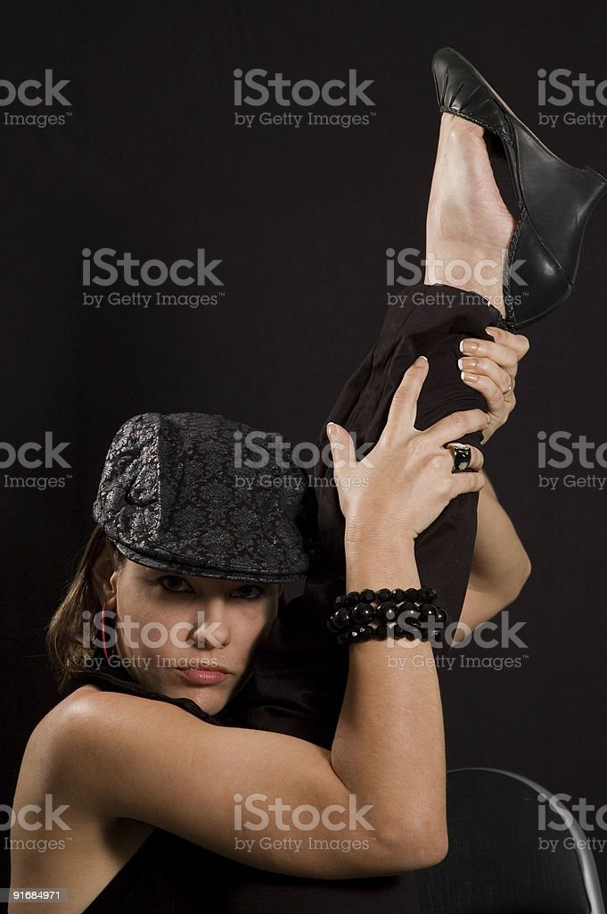 Dancer girl with leg up stock photo