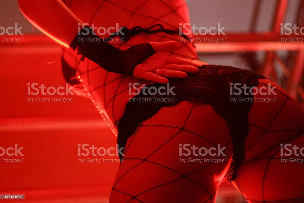 Dancer in a red light stock photo