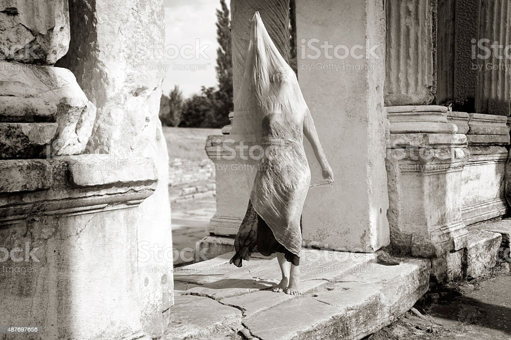 Dancer in ancient temple ruins stock photo