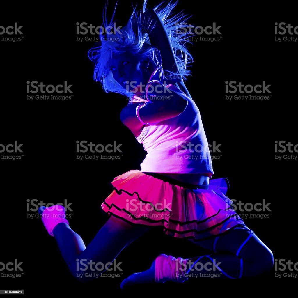 Dancer in black light royalty-free stock photo