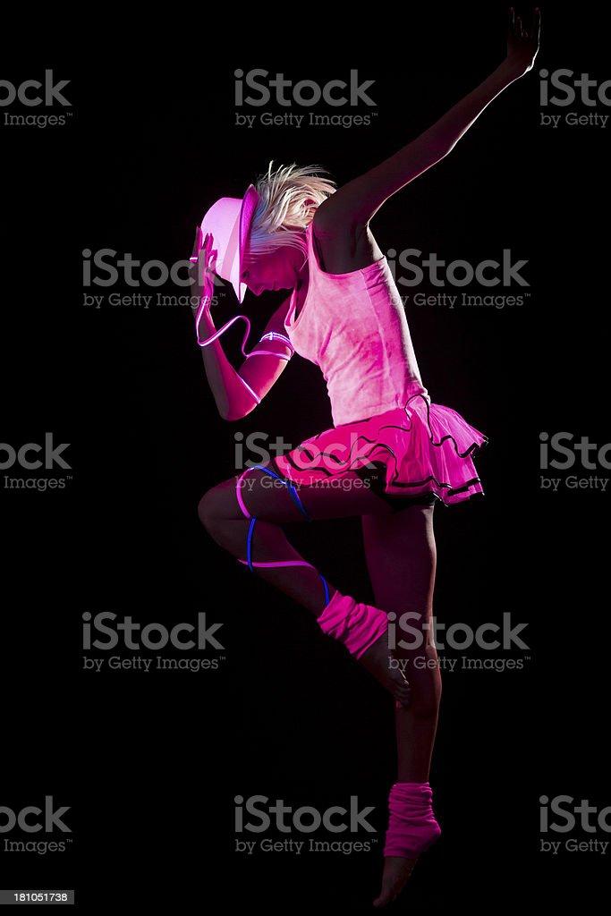Dancer in black light stock photo