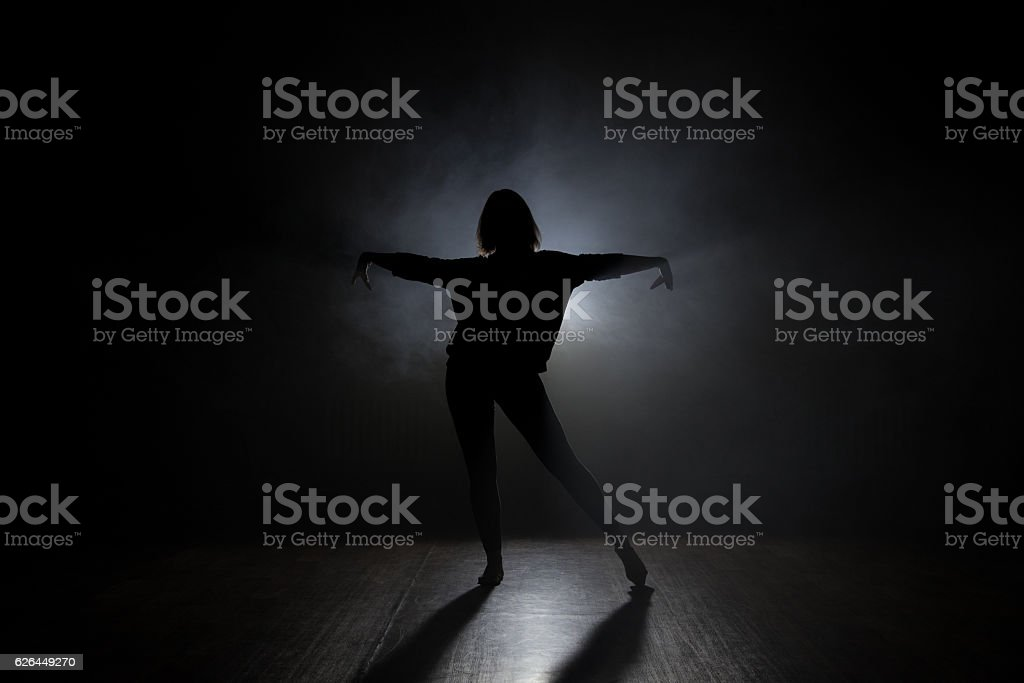 Dancer in studio with smooke on a dark background stock photo
