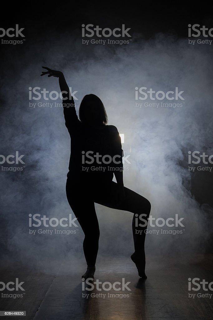 Dancer in the dark and smoke stock photo