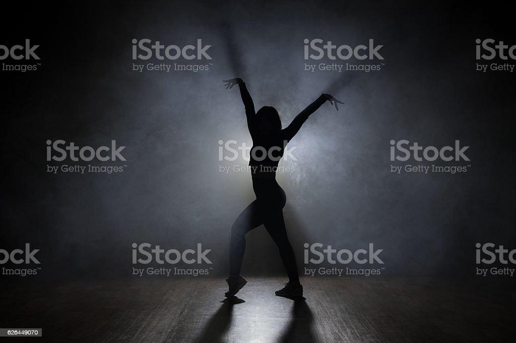 Dancer in the studio, silhouette. stock photo