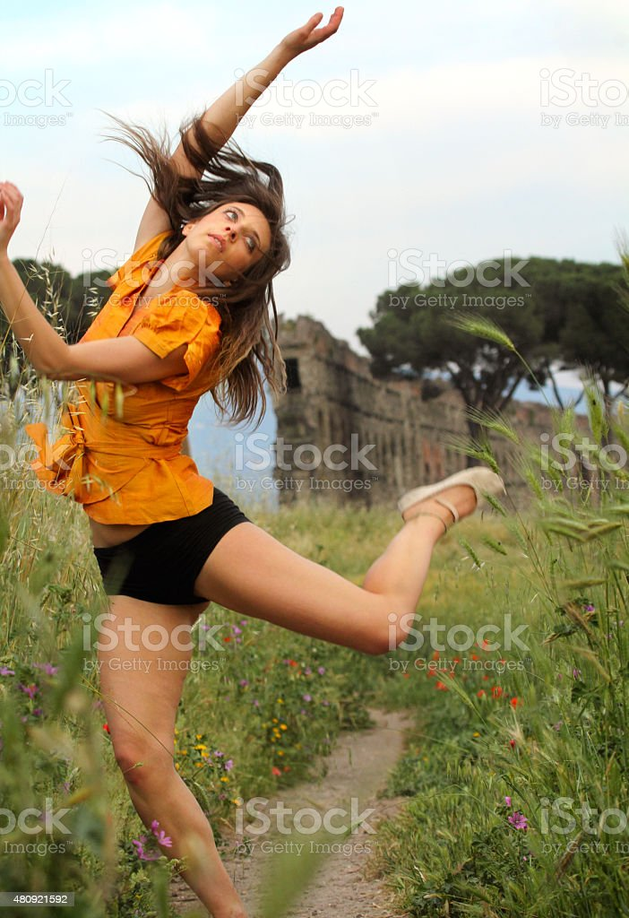 Dancer interpreting ruins of the Claudian aqueducts in Rome. stock photo