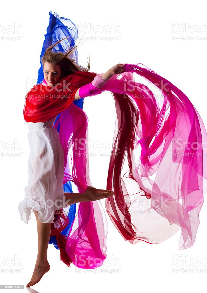 Dancer jump on white background with colorful fabric royalty-free stock photo