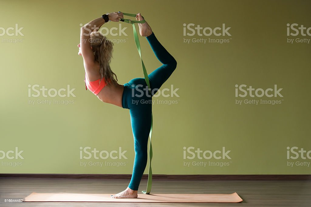 Dancer king yoga pose stock photo
