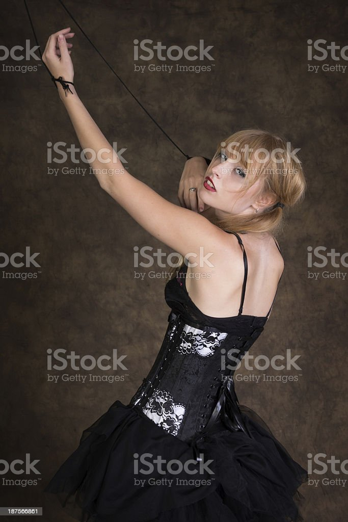 Dancer marionette looking over shoulder at camera. royalty-free stock photo