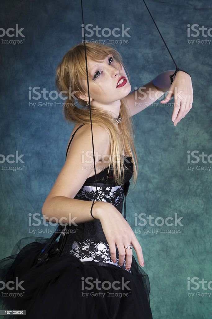Dancer marionette looking up to source of strings. royalty-free stock photo