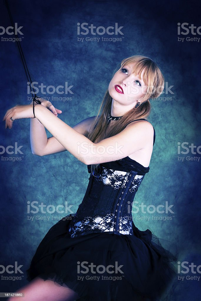 Dancer marionette, side view looking up. royalty-free stock photo