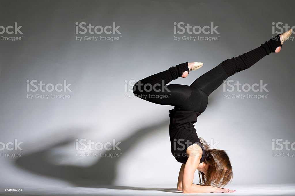 Dancer on gray background royalty-free stock photo