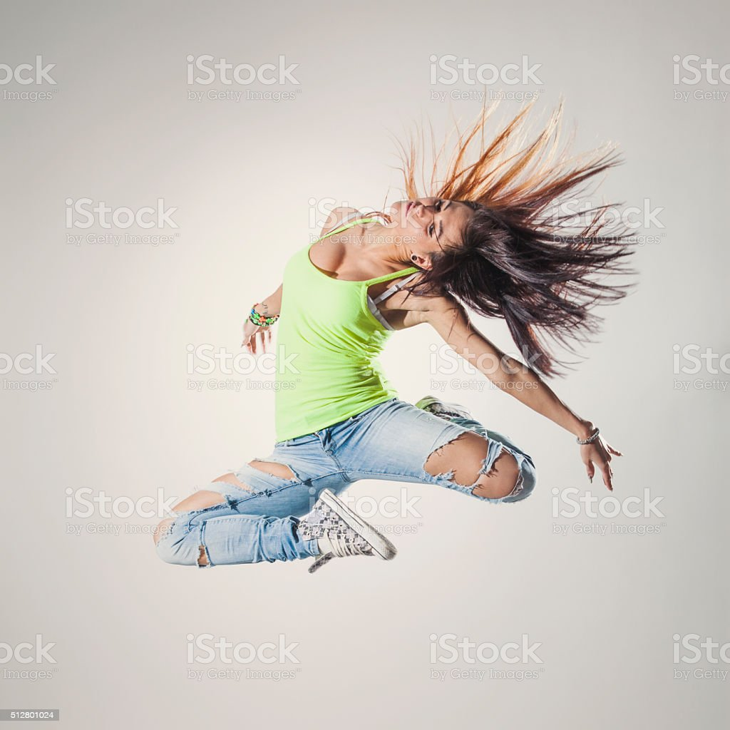 dancer posing on a studio background stock photo