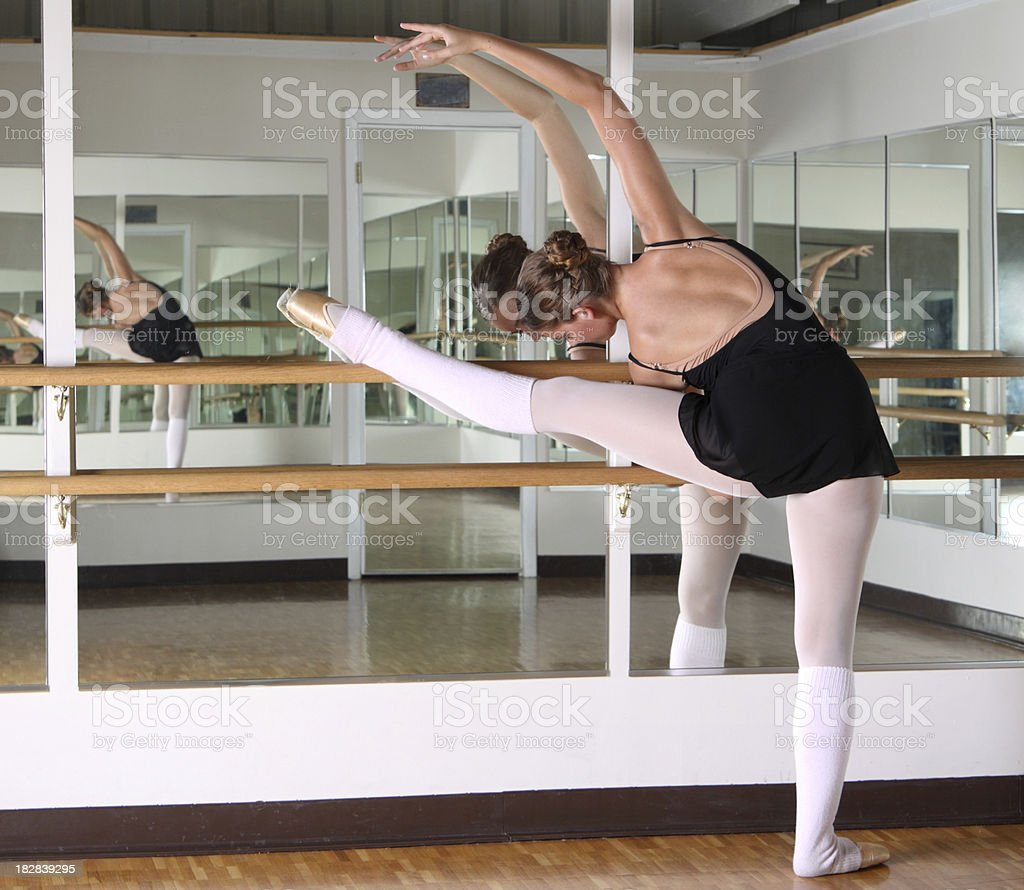 Dancer streching at the barre royalty-free stock photo
