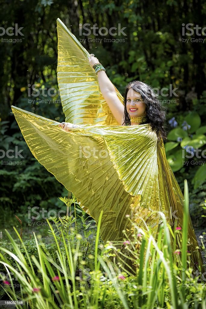 Dancer with golden Isis wings stock photo