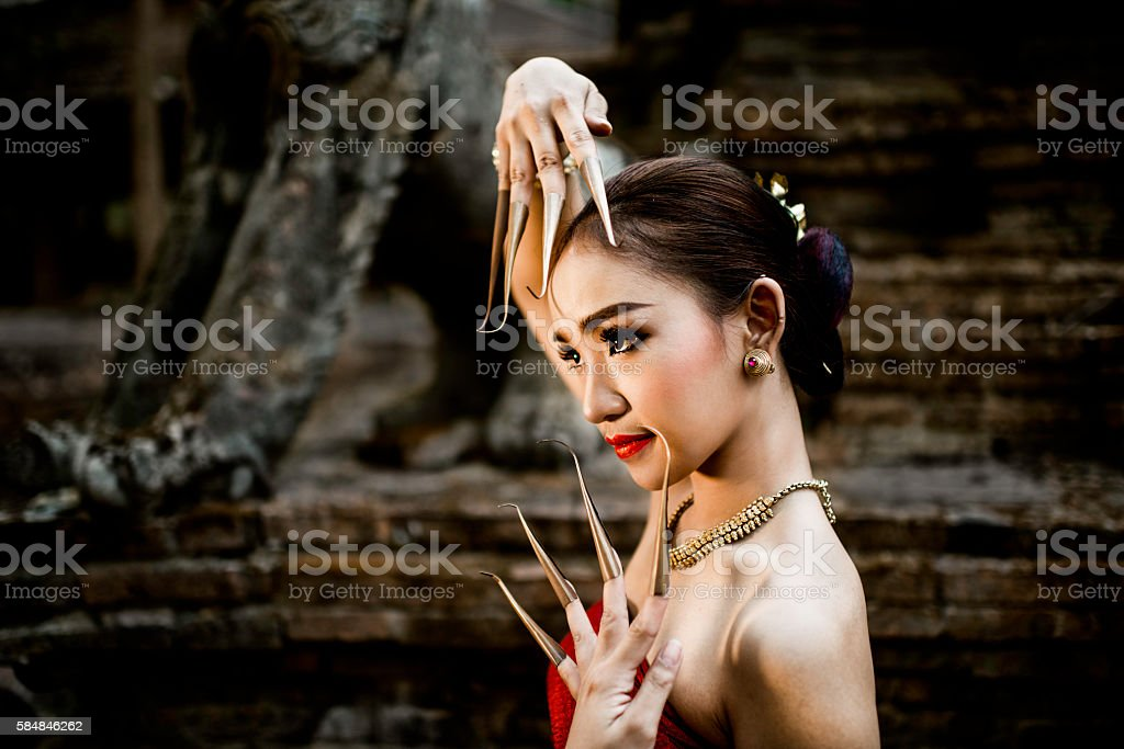 Dancer with Long Finger Extenders stock photo