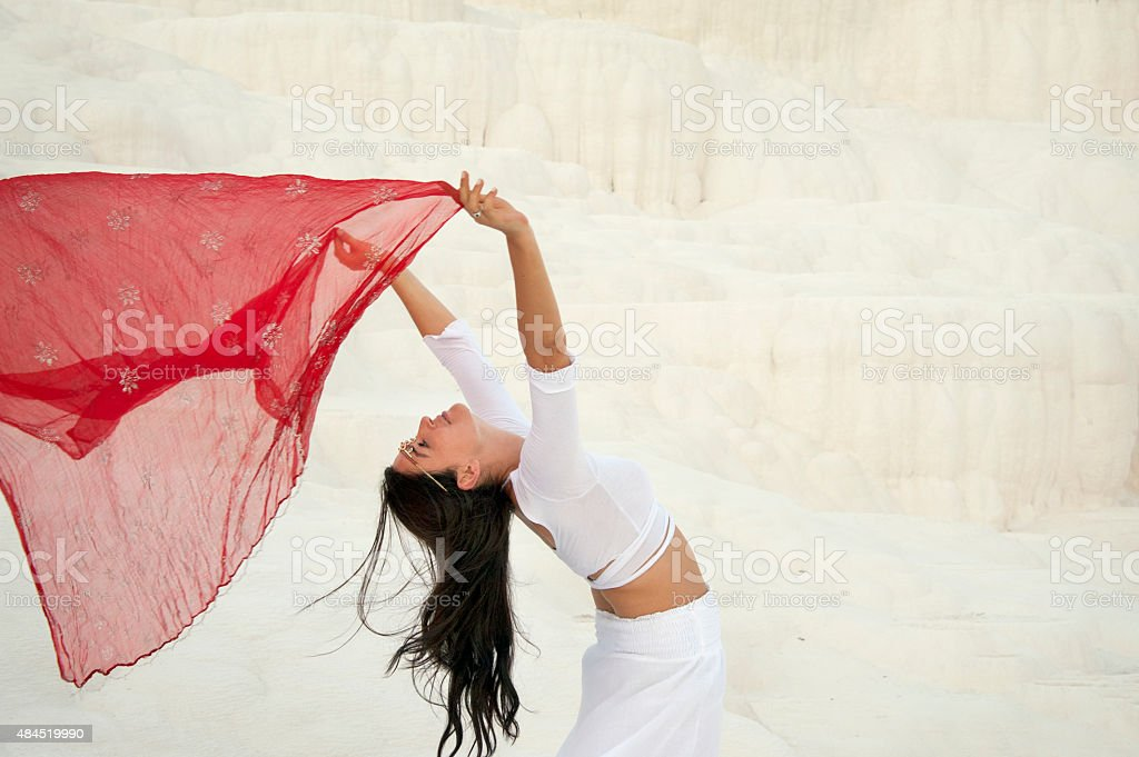 Dancer with red veil stock photo