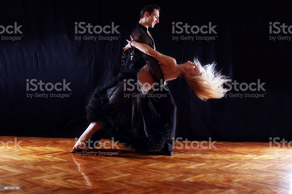 dancers in ballroom against black background stock photo