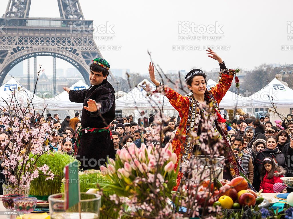 Dancers in traditional persian costume and Eiffel tower. Nowruz. stock photo