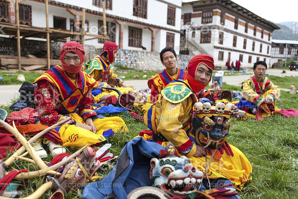 Dancers relax after performance at Thimphu monastery stock photo