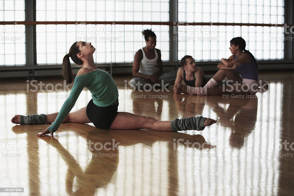 Dancers stretching before practice stock photo