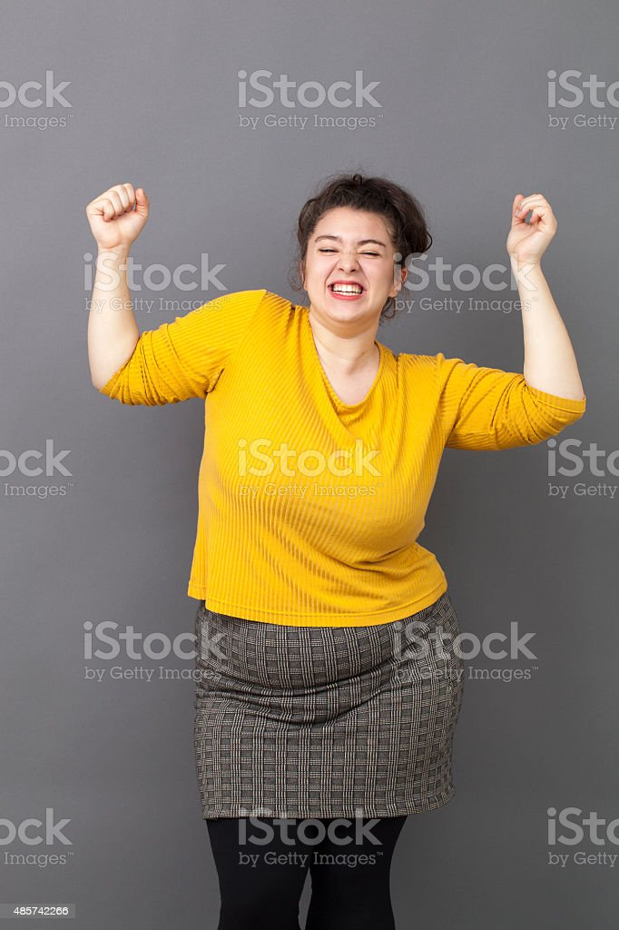 dancing 20s big woman expressing excitement stock photo