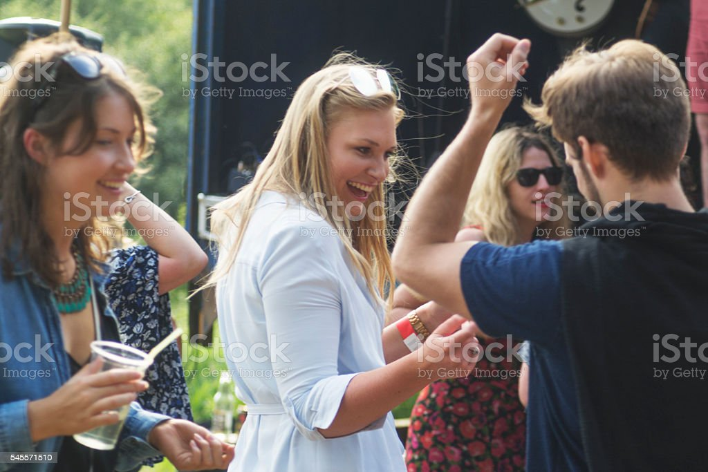 Dancing and drinking at the music festival stock photo