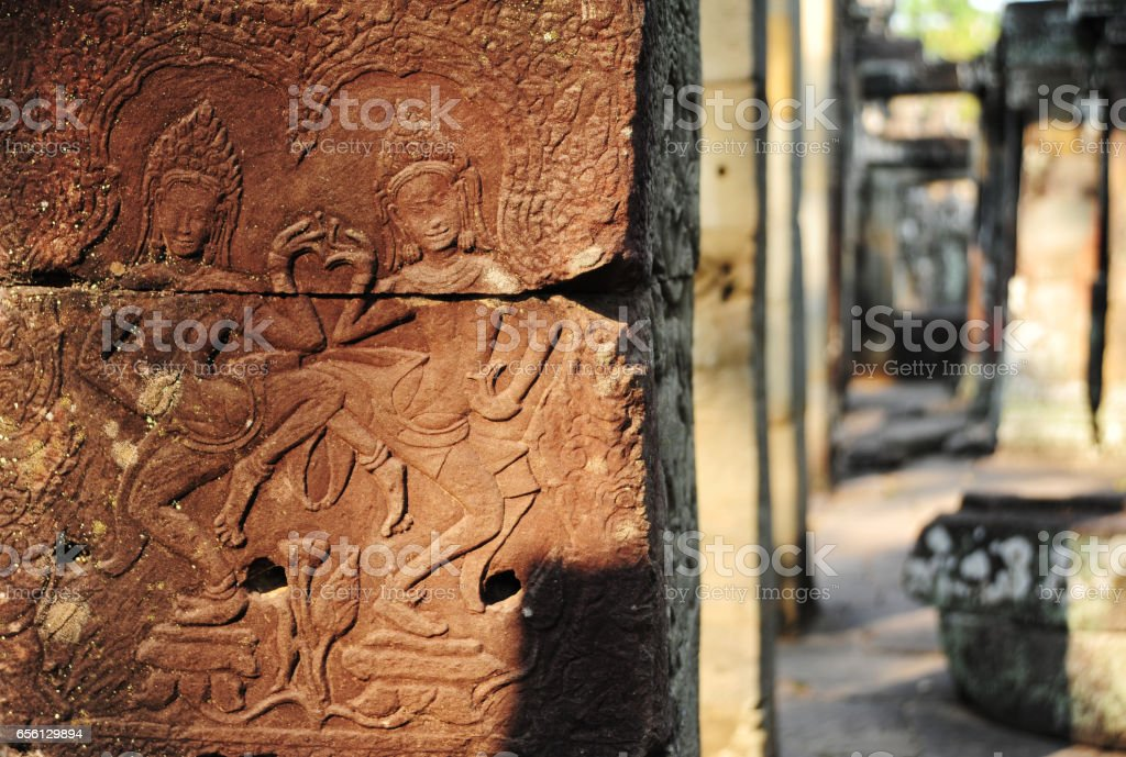 Dancing Apsaras bas relief in Angkor Thom stock photo
