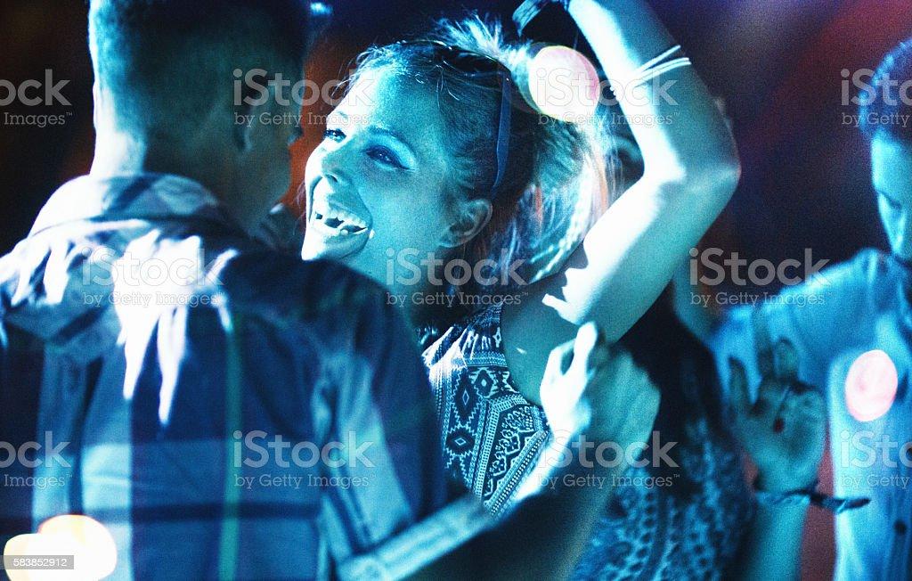 Dancing at concert. stock photo
