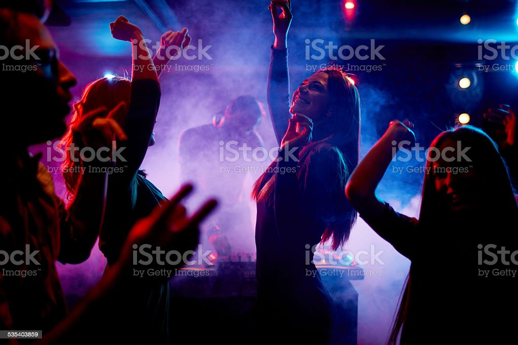 Dancing at disco stock photo