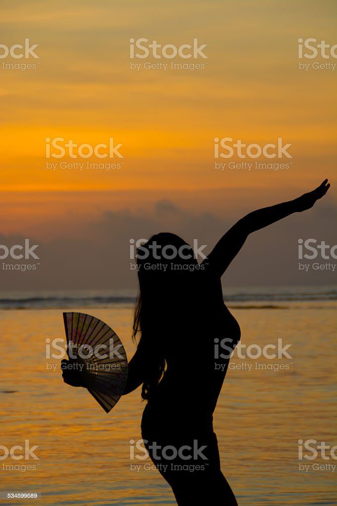 Dancing at sunset stock photo